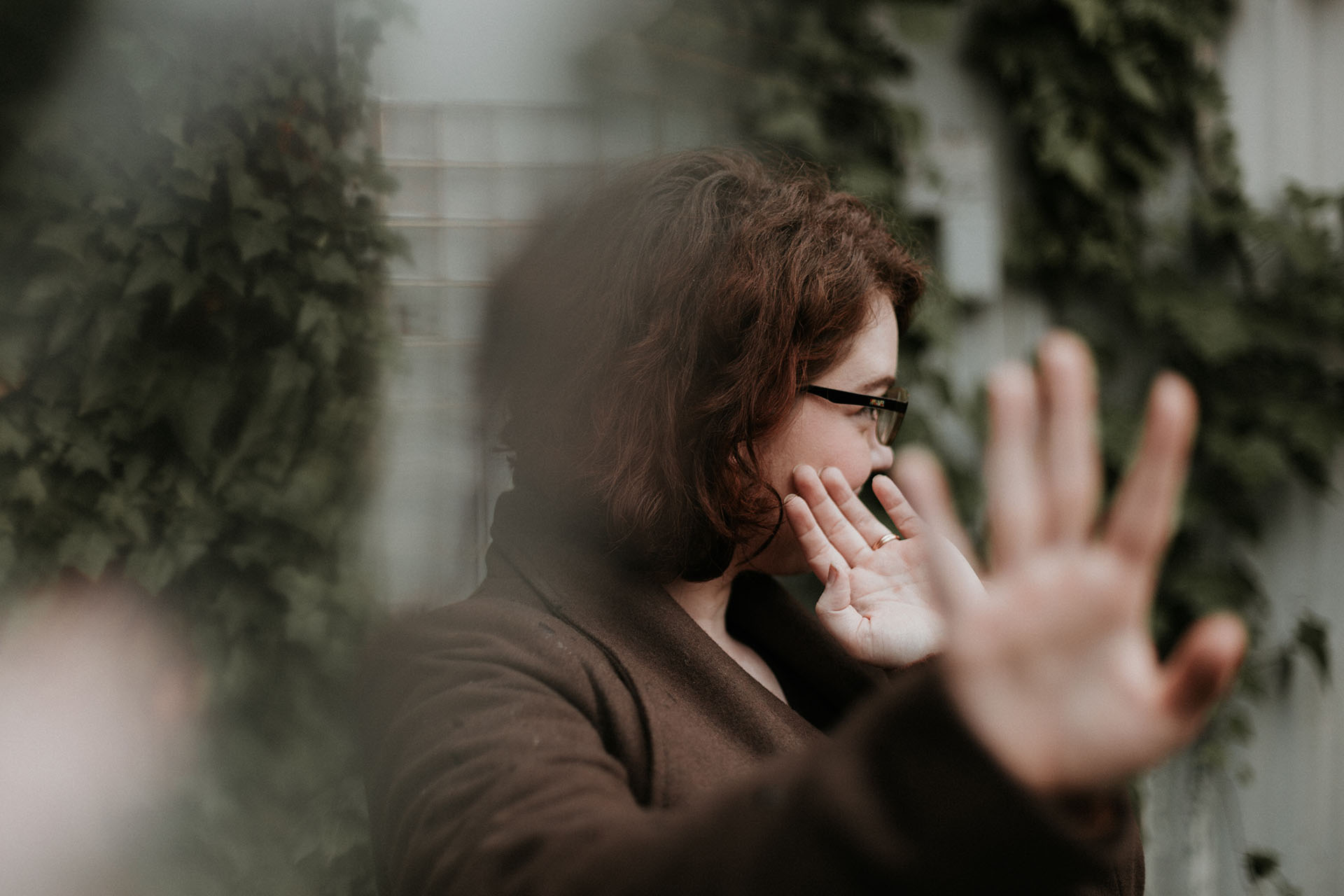 a woman putting her hand out and resisting an offer