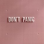 Don't Panic text on a pegboard