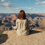 girl meditating on cliff