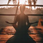 woman relaxing to practice mindfulness and address defense mechanisms
